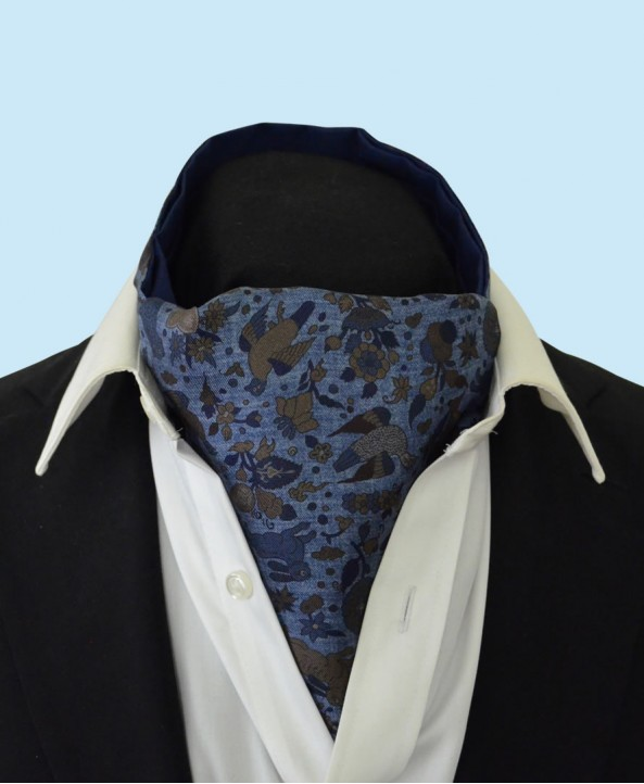 Silk Cravat with a Whimsical Secret Garden Design in Olive Green and Navy on a Stonewashed Denim Style Background