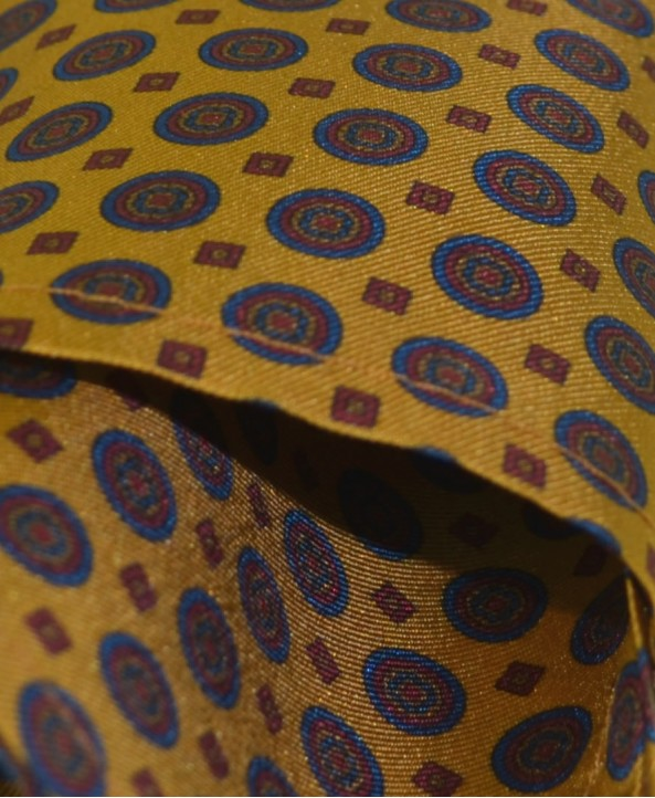 Fine Silk Bullseye Medal Pattern Hank in Dark Yellow